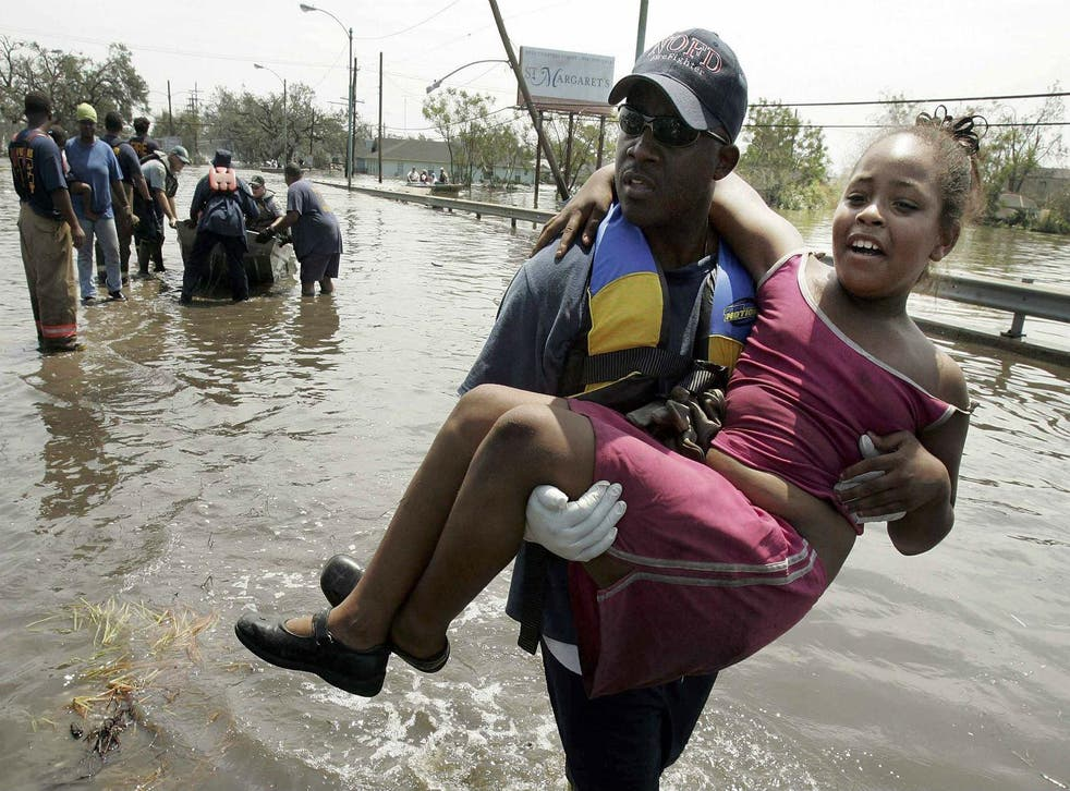 A girl is rescued in New Orleans after Hurricane Katrina