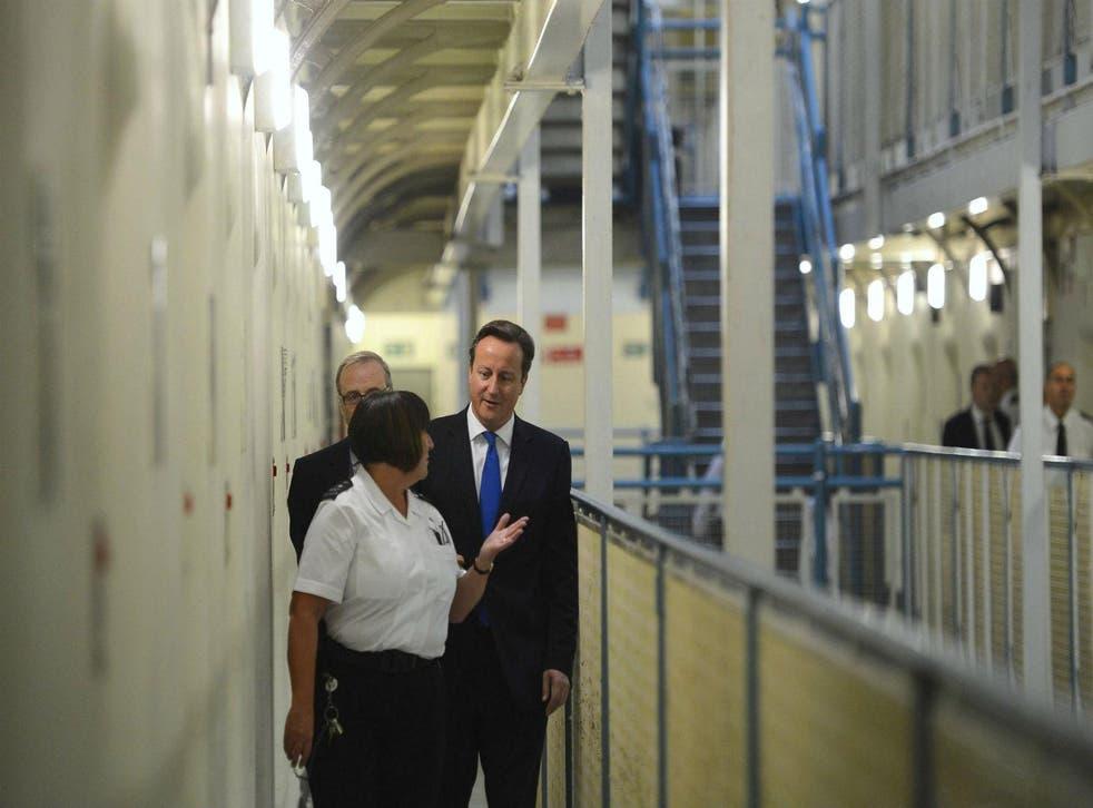 David Cameron visits Wormwood Scrubs prison in 2012