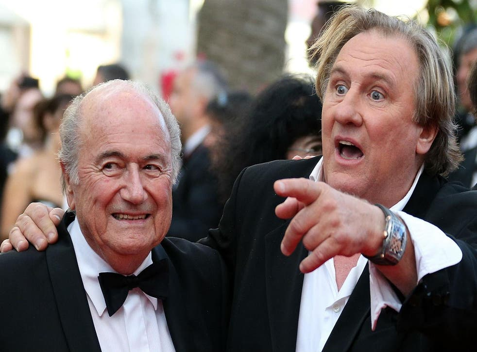 Sepp Blatter and Gerard Depardieu at a screening of United Passions at the Cannes Film Festival