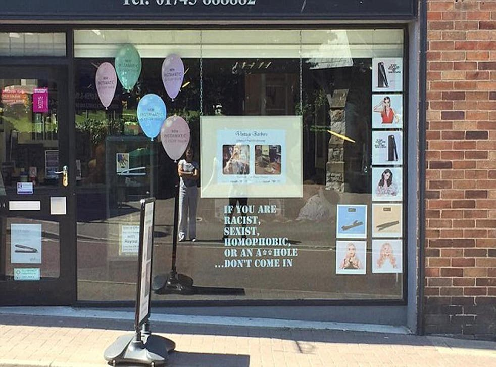 Russell Hughes, who owns Russell Paul Hairdressing in Prestatyn, put a sign in his salon window on Tuesday which reads: If you are racist, sexist, homophobic or an a***hole... don't come in