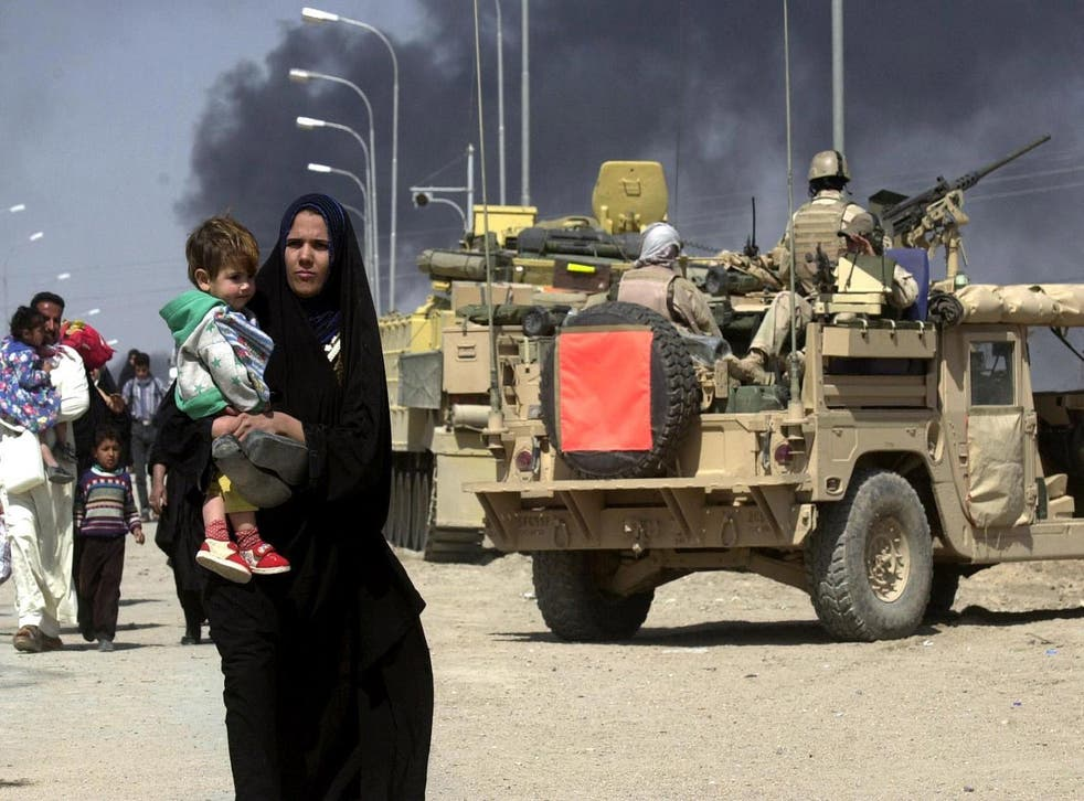 Residents fleeing the Iraqi city of Basra in March 2003