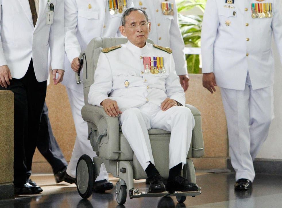 Thai King Bhumibol Adulyadej arrives at Siriraj Hospital after he marks the 60th anniversary of his coronation at the Grand Palace on May 5, 2010 in Bangkok, Thailand.