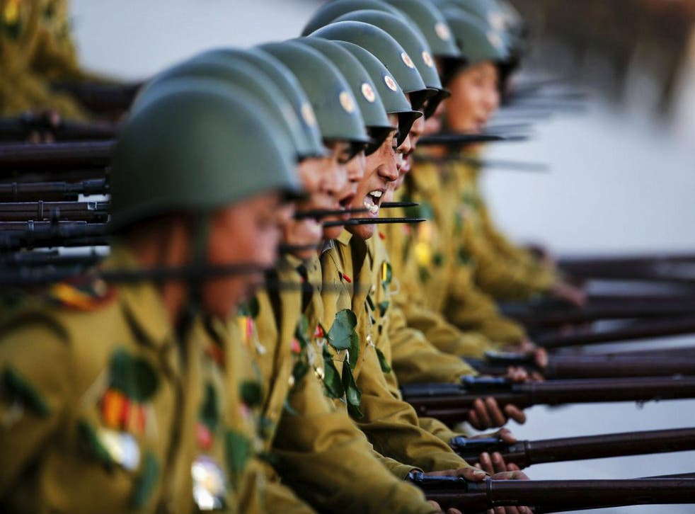 Soldiers shout slogans as they march past a stand with North Korean leader Kim Jong Un and other officials on 10 October, 2015. Picture: Reuters/Damir Sagolj