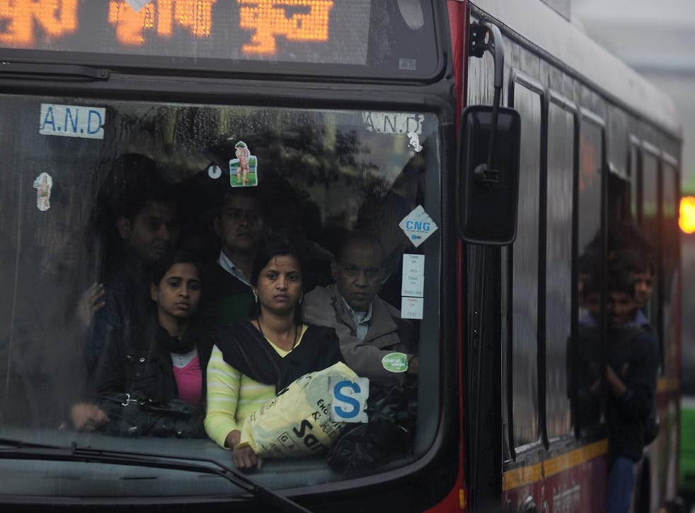 Women travel on a bus in New Delhi
