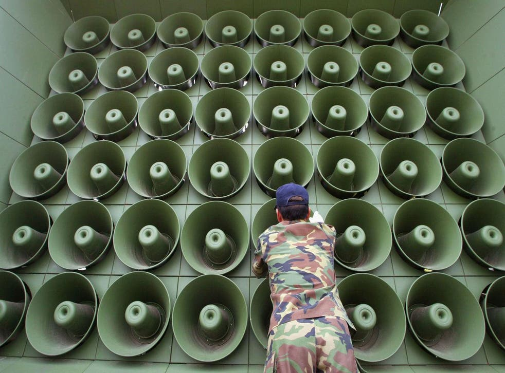 In this stock image, a South Korean soldier takes down a battery of propaganda loudspeakers on the border with North Korea on 16 June 2004 in Paju, South Korea.
