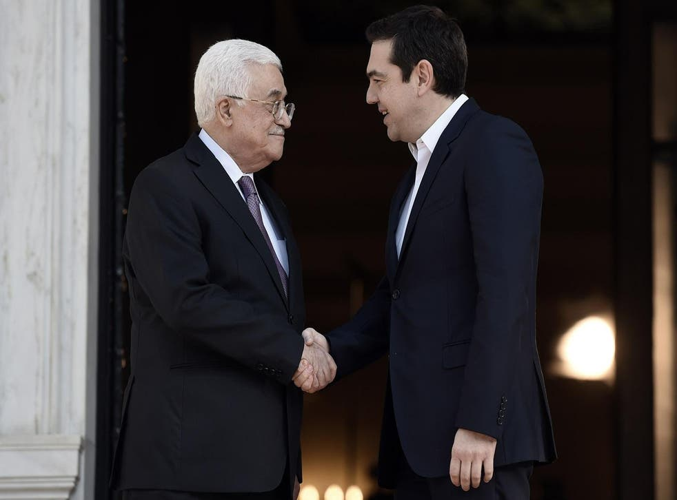 Alexis Tsipras shakes hands with Palestinian president Mahmud Abbas