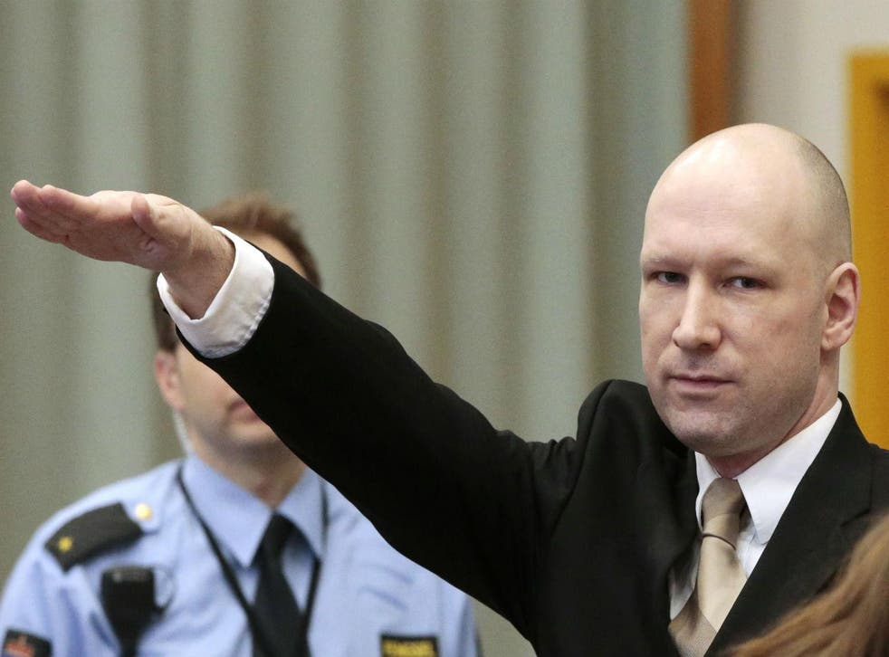 Anders Behring Breivik makes a Nazi salute as he enters the court room in Skien prison, March 15, 2016