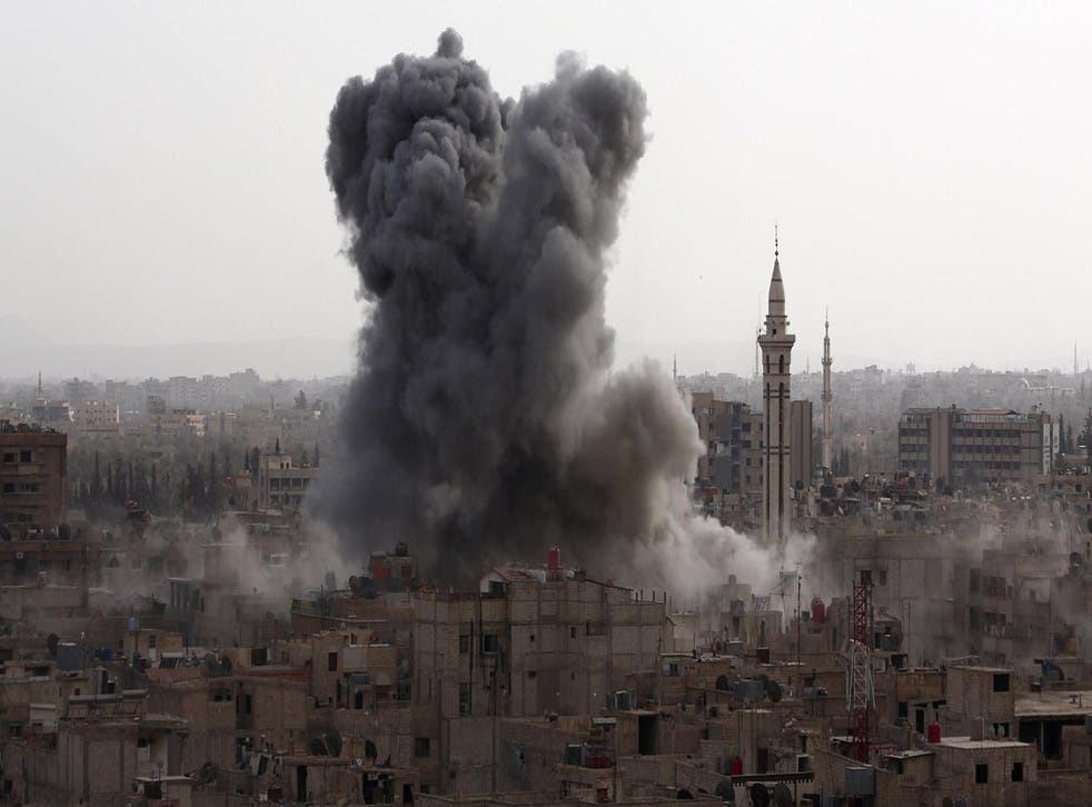 Smoke billows from the Syrian rebel-held area of Douma, east of the capital Damascus on 16 September 2015