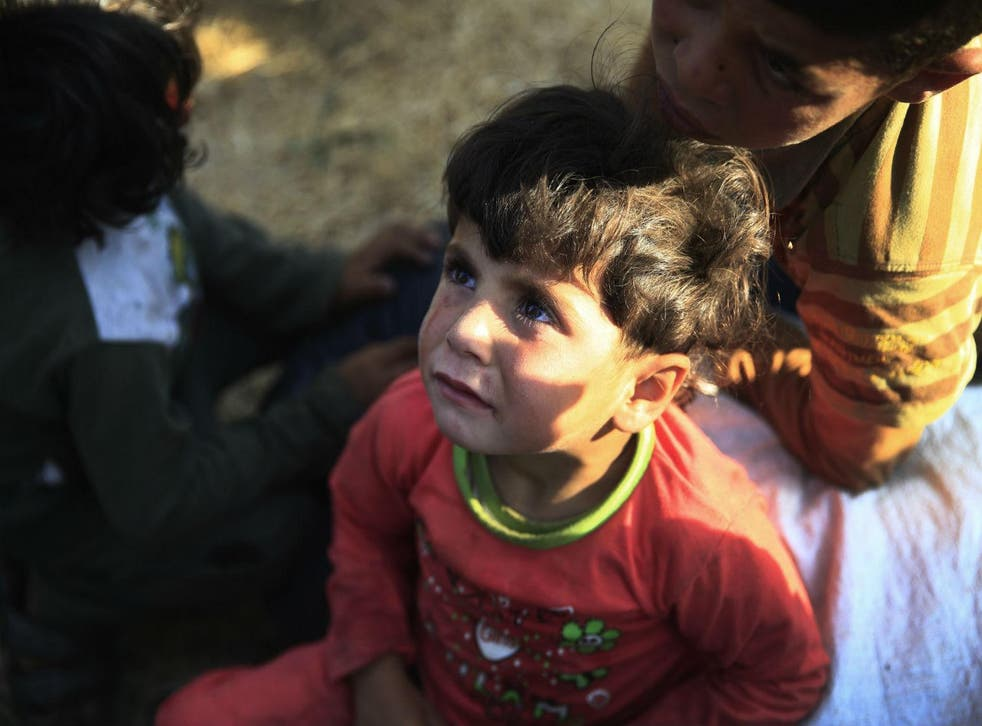 A small boy trapped near Akcakale on the Turkish-Syrian border after fleeing from Isis militants
