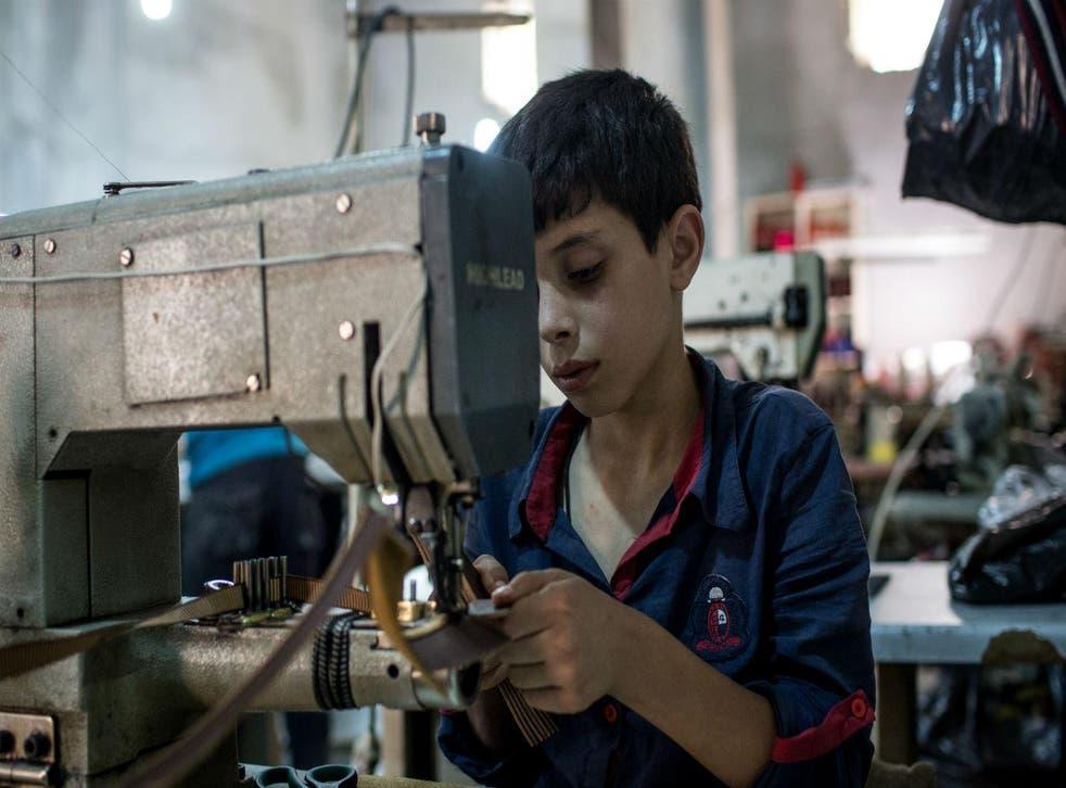 Picture: Chris McGrath/Getty, Syrian refugees working in Turkey