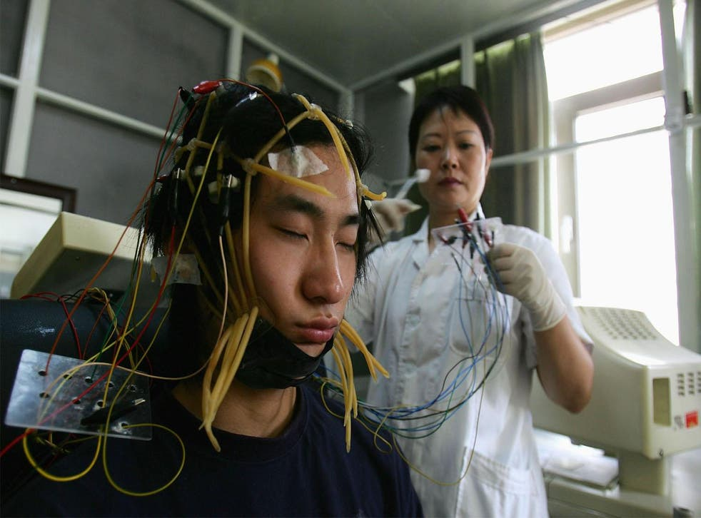 A young Chinese internet addict receives an electroencephalogram check in Beijing, China.