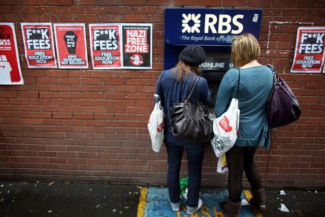 Students arriving for Manchester University's freshers week queue up at a cash machine
