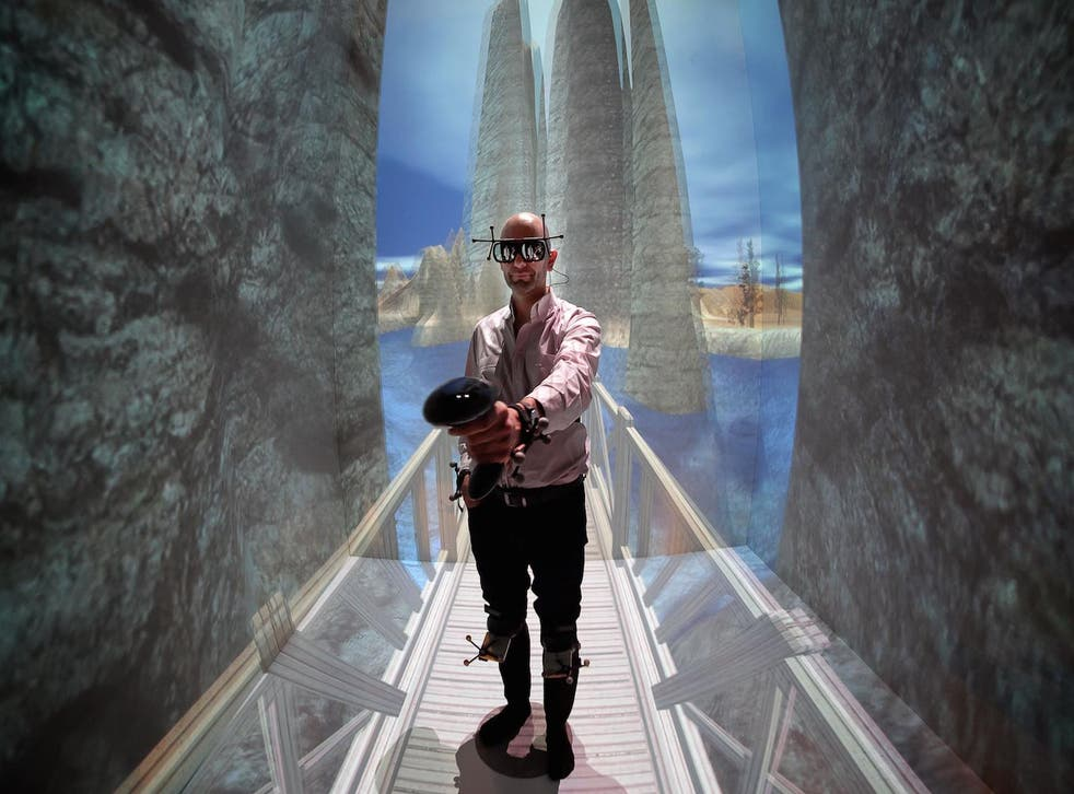 French patient Denis Duet wearing a virtual reality headset undergoes a VR therapy session