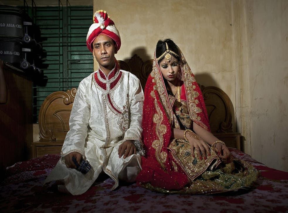 A 32 year old groom and his 15 year old bride on 20 August 2015 in Manikganj, Bangladesh
