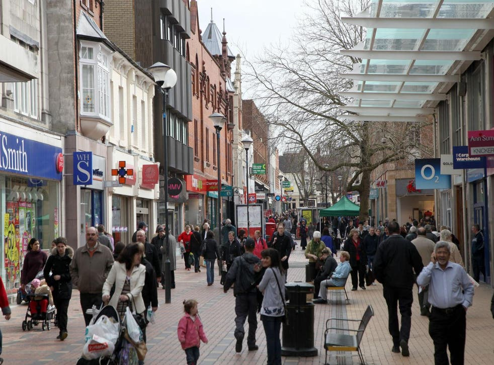 People walk around the centre of Swindon in 2010