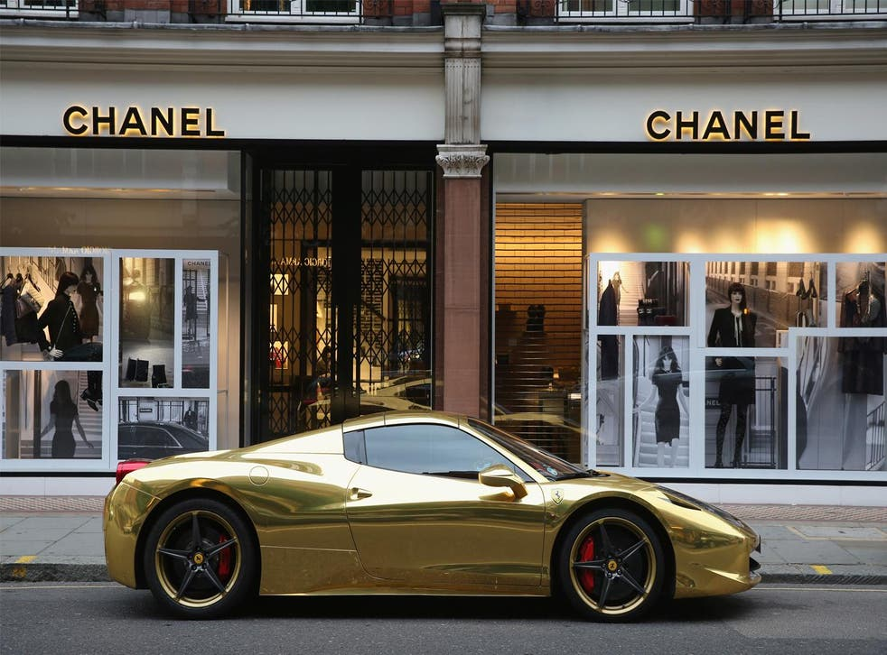 A Gold Ferrari sits outside Chanel on Sloane Street on 8 August 2014 in London