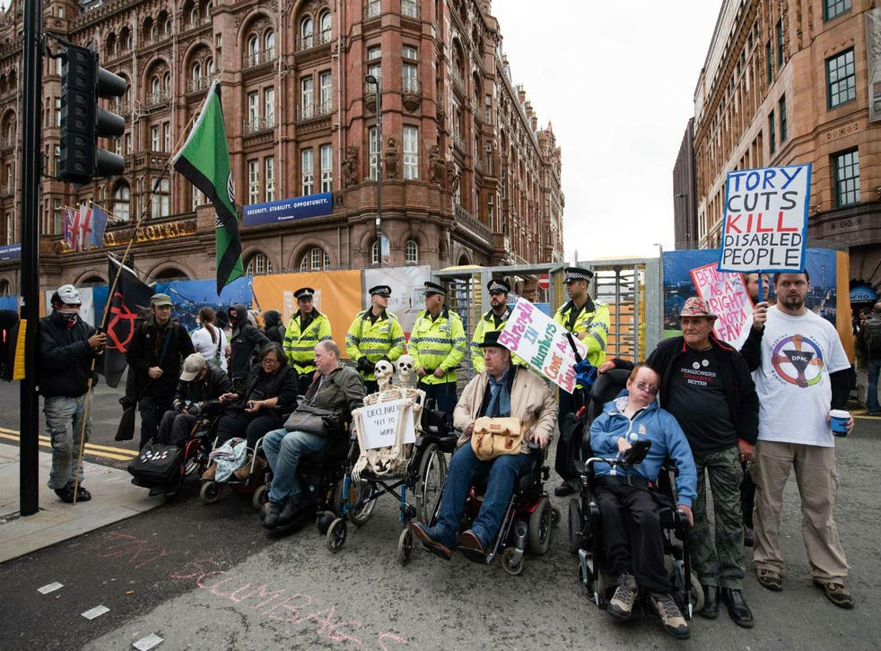 Protesters during the Tory Party conference