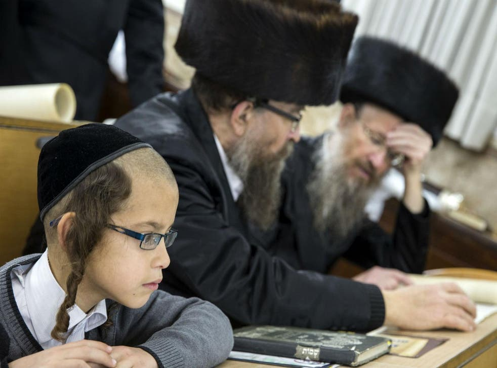 Ultra-Orthodox Jews reading at a synagogue.