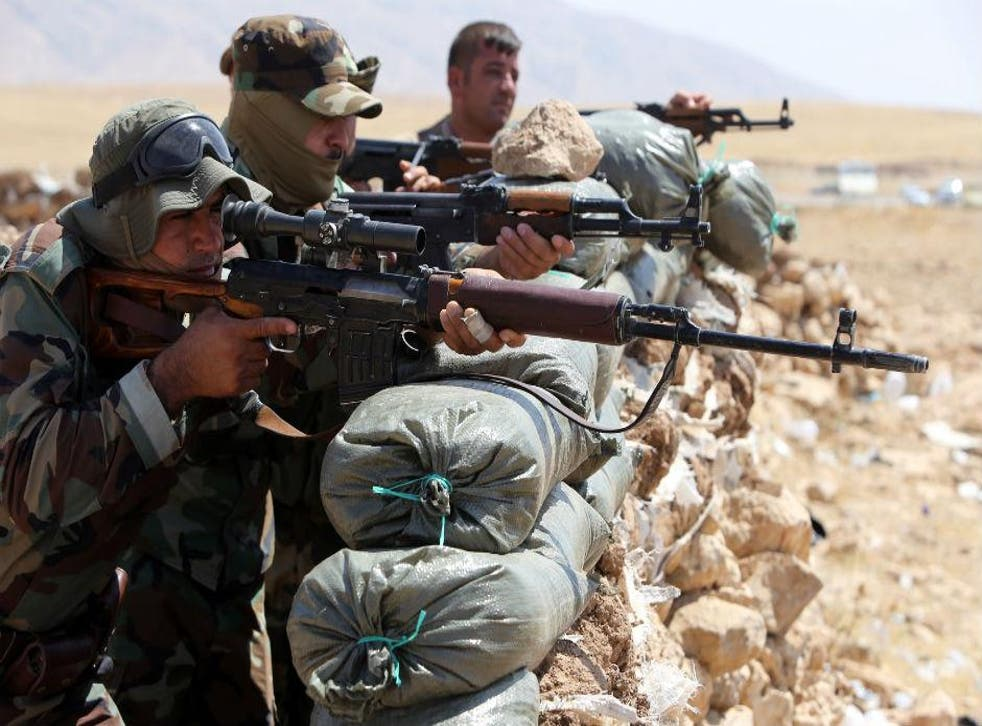 Kurdish peshmerga monitor their front line position, 13km north-east of Mosul