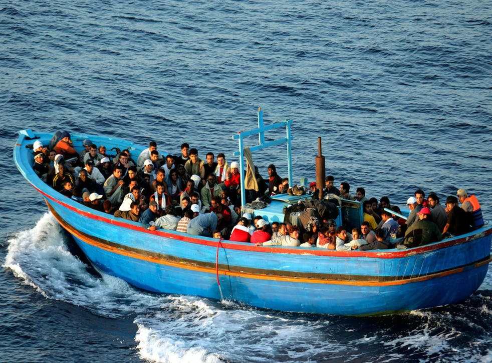 Italian border patrols pick up migrants in 2005