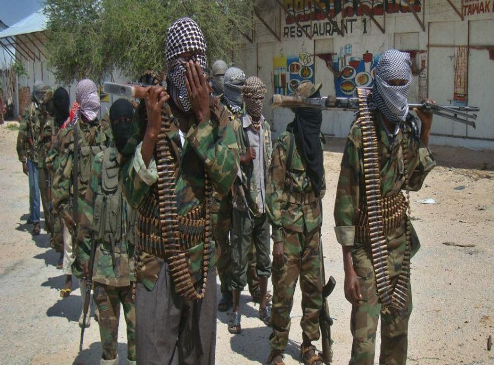 Recruits from al-Shabaab, one of the groups who have benefited from kidnapping, pose in the Somali capital Mogadishu, 2012