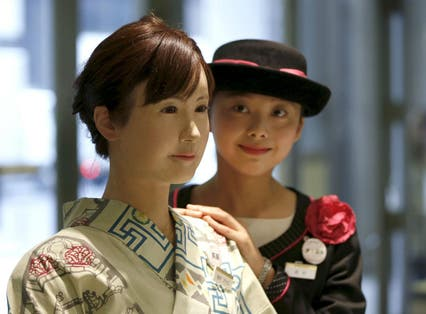 Chihira, left, with one of the store's human employees, right