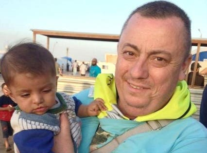 This photo of Alan Henning, at a refugee camp on the Turkey-Syria border, was released by his family