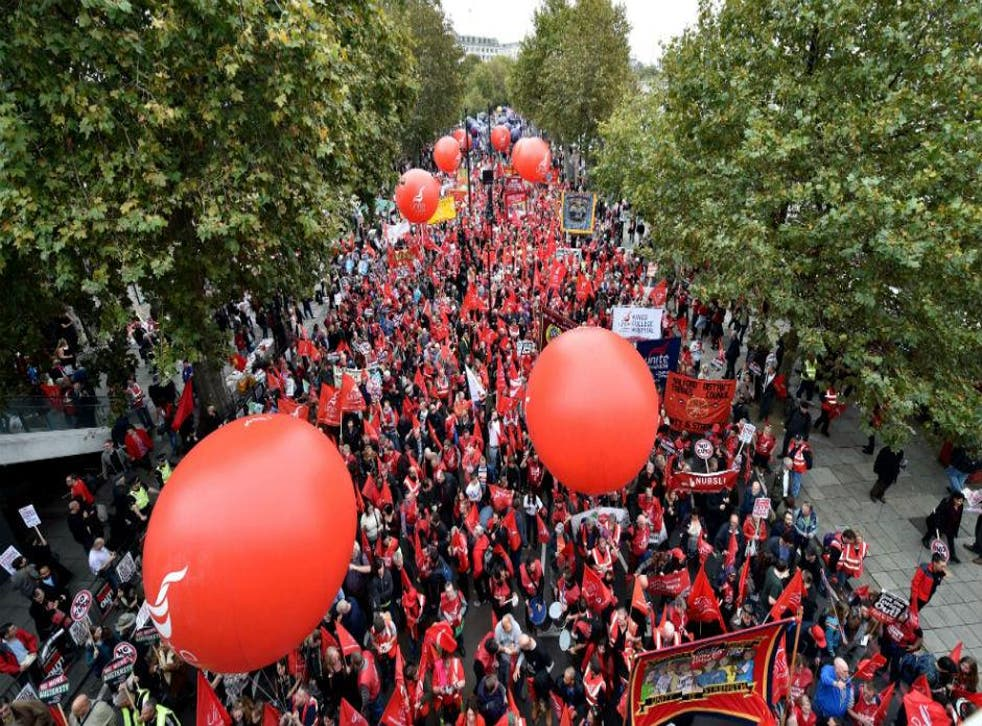Thousands of people march in London against falling real wages
