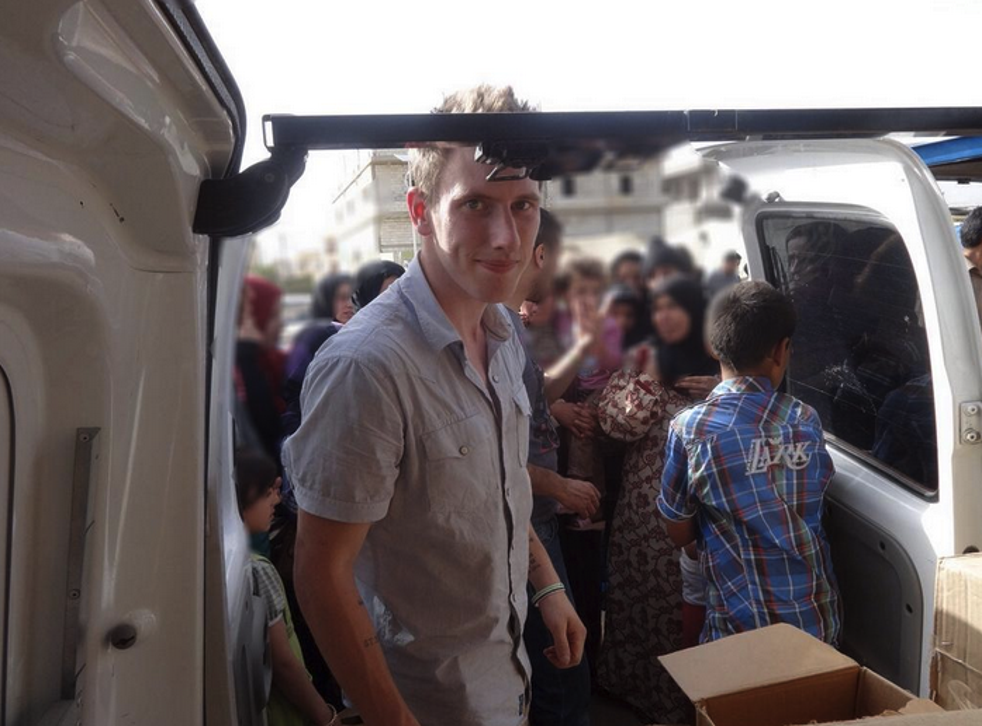 Peter Kassig delivering aid in Bekaa Valley, in Lebanon; May, 2013