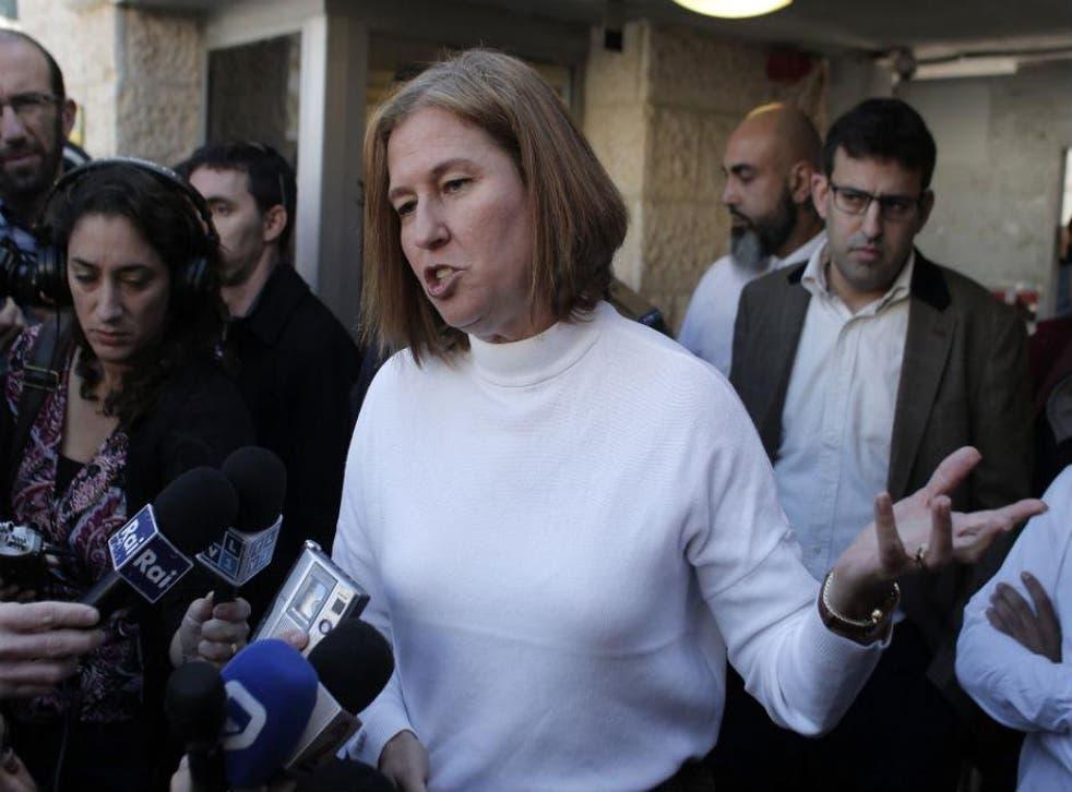 Israeli justice minister, Tzipi Livni, speaks to the press outside the Hand in Hand school in Jerusalem, Beit Safafa neighbourhood