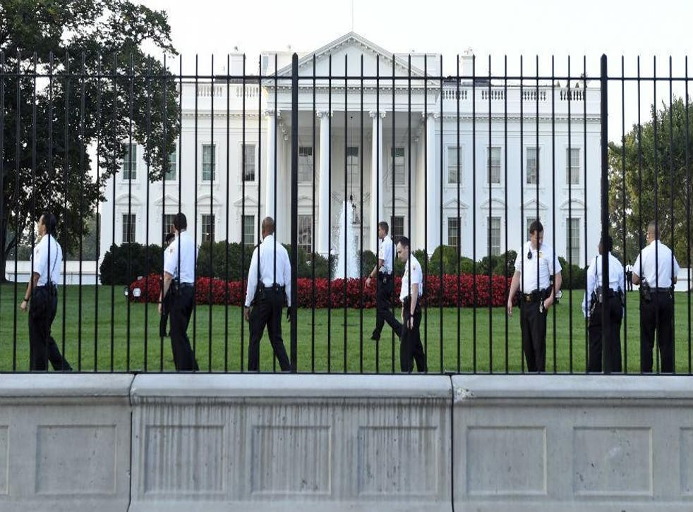 Guards patrol the White House lawn after a man jumped over the fence on Friday