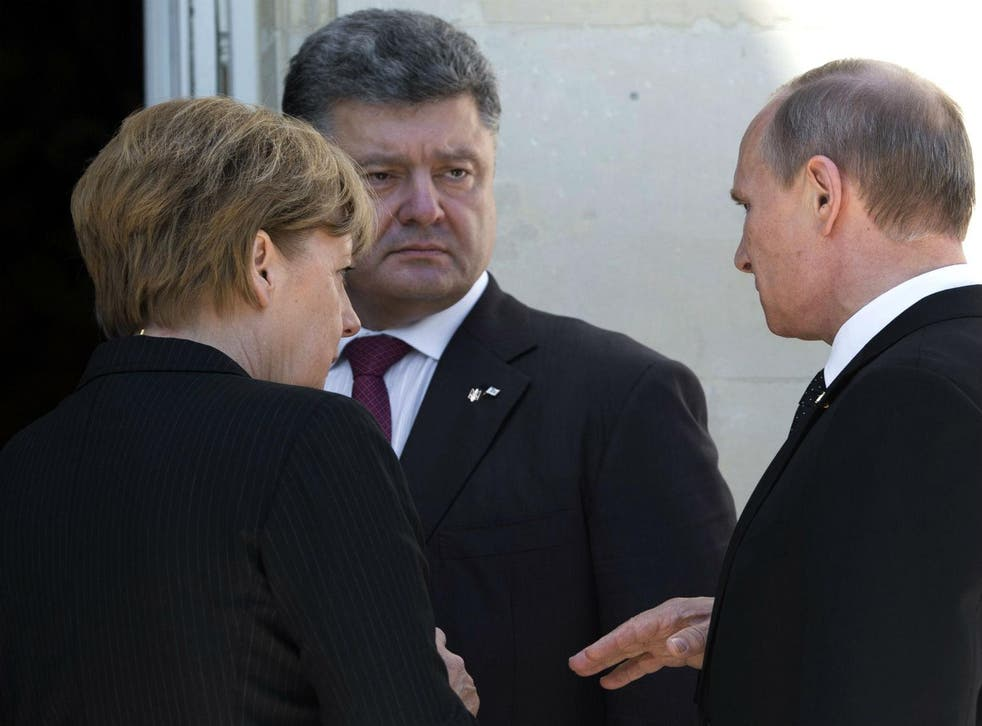 Angela Merkel, with Ukrainian president Petro Poroshenko and his Russian counterpart Vladimir Putin