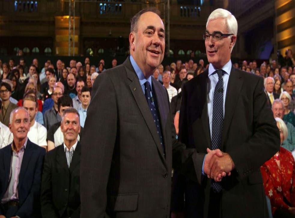 This image has been reversed to show what Alex Salmond presumably looks like when he shakes hands now (Picture: David Cheskin/AFP/Getty