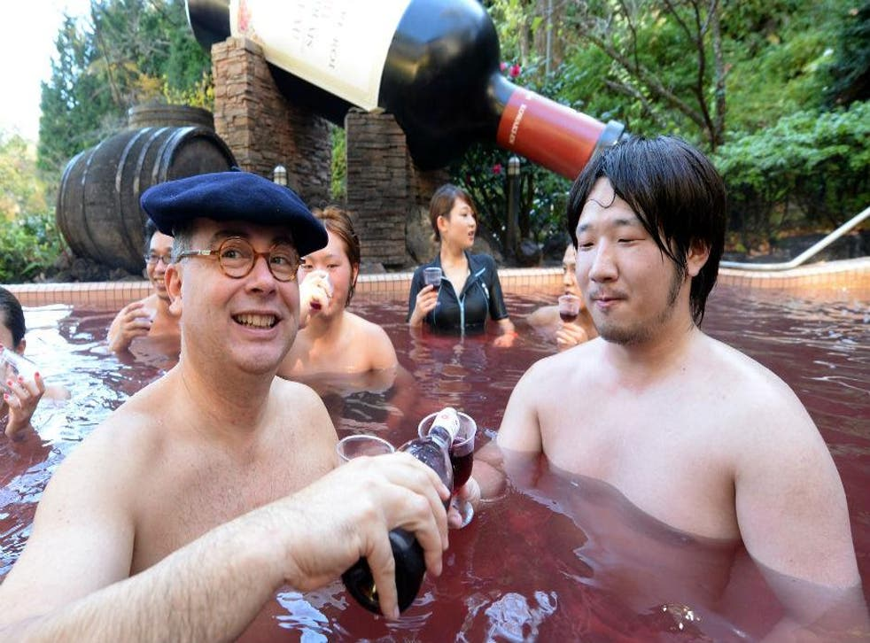 Wine maker Thibault Garin with a guest at the Hakone Yunessun spa resort in Japan