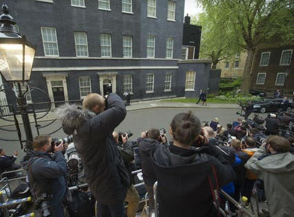 David Cameron arrives at Downing Street on Friday morning with his wife Samantha