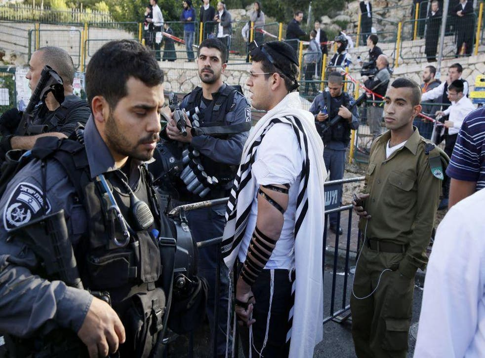 Israeli security forces secure the scene after the attack