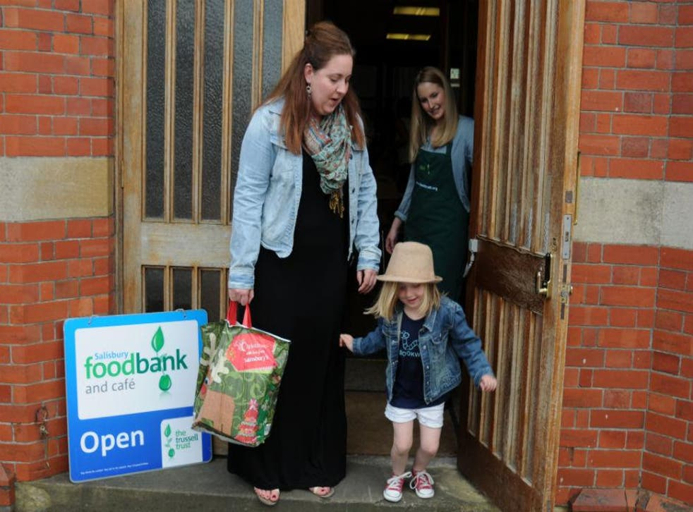 Holly Jones, 29, and her five-year-old daughter Phoebe getting help at a food bank in Chichester, Sussex