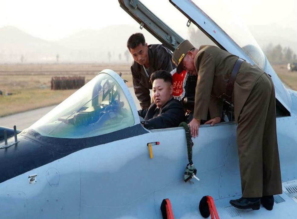 Kim Jong Un inspects a Korean People's Army flight drill at an unnamed location