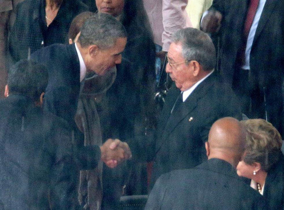 The US and Cuban presidents shake hands at Nelson Mandela's funeral last year - the first such gesture since 1959
