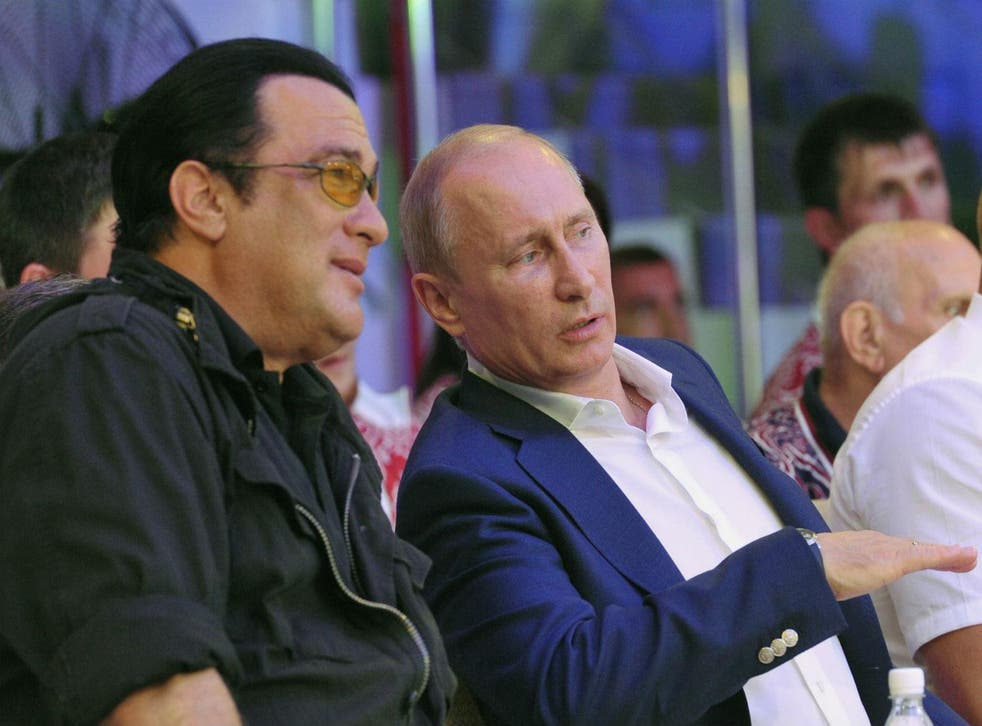 Steven Seagal and Vladimir Putin watch martial arts together in 2012