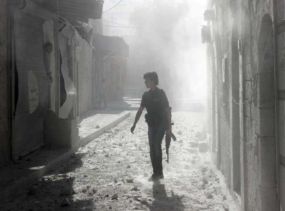 A rebel fighter on the streets of Aleppo in April