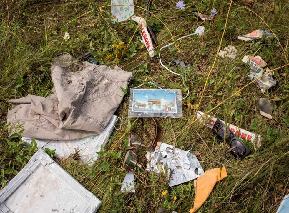 Luggage and personal possessions from MH17 victims at the site of the crash