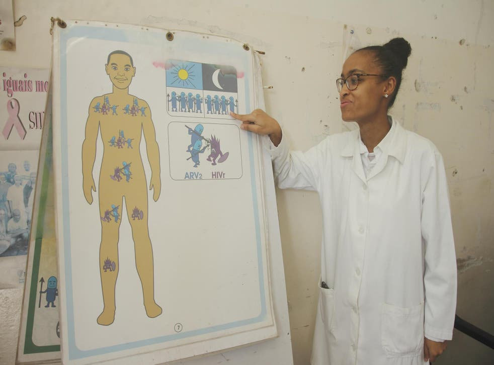 On the frontline: Dr Sheila Issufo shows how antiretrovirals work at Clinic 1 Maio in Maputo, Mozambique