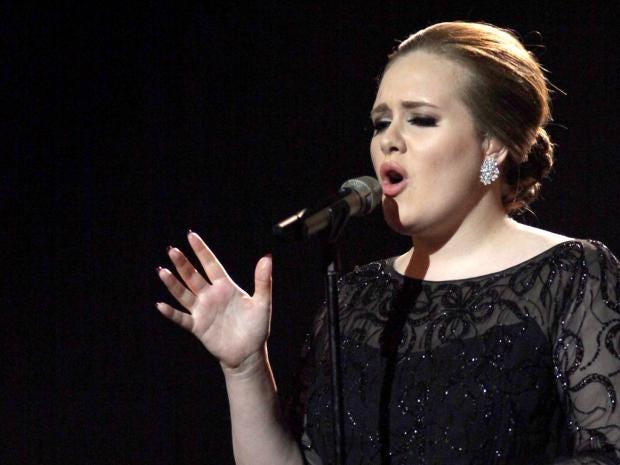 10-Billboard-Adele-AP.jpg