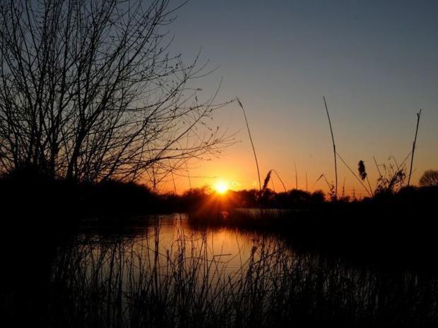 AN18681688The-sun-sets-over.jpg