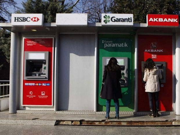 cashmachinesREUTERS.jpg