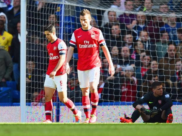 A-dejected-Mikel-Arteta-and.jpg