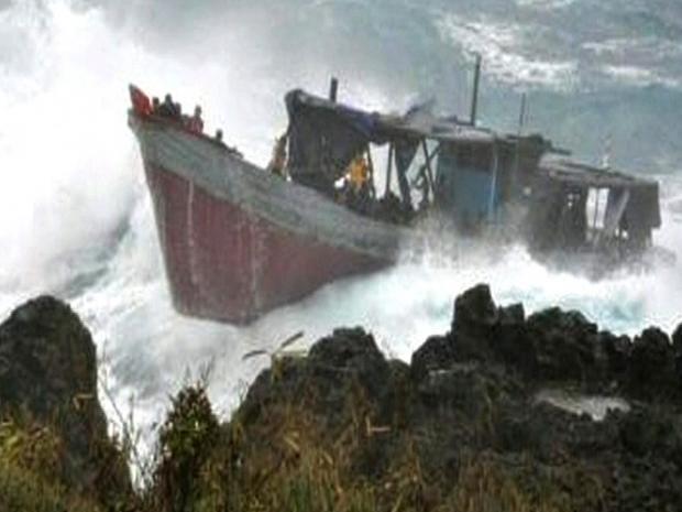 pg-21-aus-boat-reuters.jpg