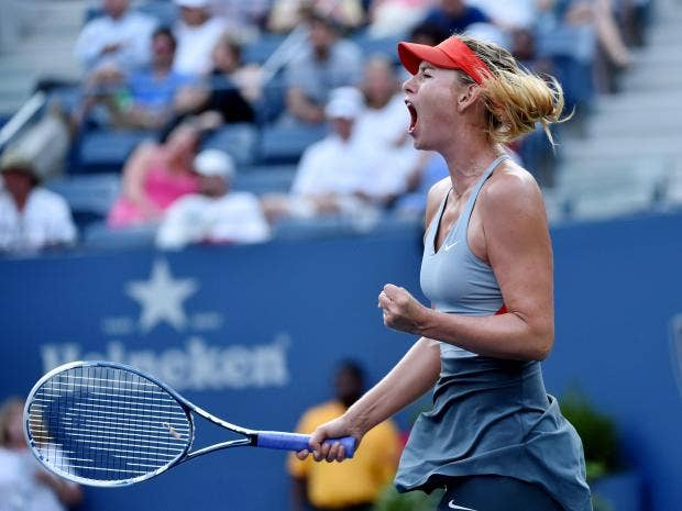 Maria-Sharapova-of-Russia-reacts-to-winning-a-game-against-Alexandra-Dulgheru.jpg