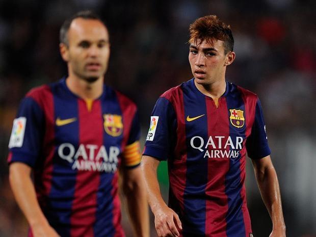 Munir-El-Haddadi-of-FC-Barcelona-looks-on-beside-Andres-Iniesta-during-the-La-Liga-match-between-FC-Barcelona-and-Elche-FC.jpg
